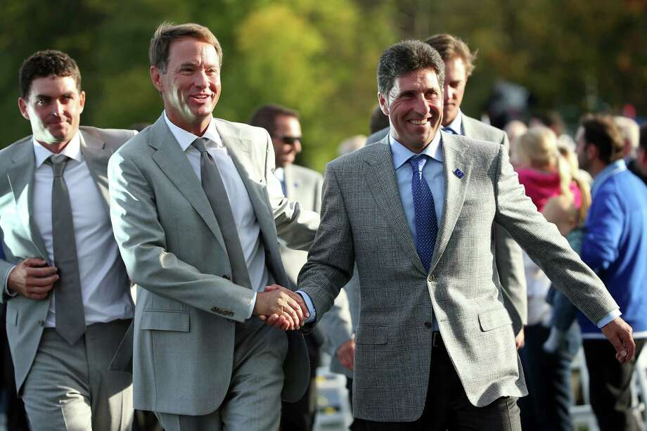 MEDINAH, IL - SEPTEMBER 27:  Ryder Cup captains Jose Maria Olazabal and Davis Love III shake hands as they lead their teams into the Opening Ceremony for the 39th Ryder Cup at Medinah Country Club on September 27, 2012 in Medinah, Illinois.  (Photo by Andrew Redington/Getty Images)  *** BESTPIX *** Photo: Andrew Redington, Getty Images / 2012 Getty Images
