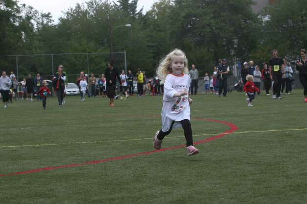 Emma Crino, 3,  runs in the Bigelow Tea 25th Anniversary Community Challenge in Southport, Conn. on September 30, 2012. Photo: Unknown, B.K. Angeletti / Connecticut Post freelance B.K. Angeletti