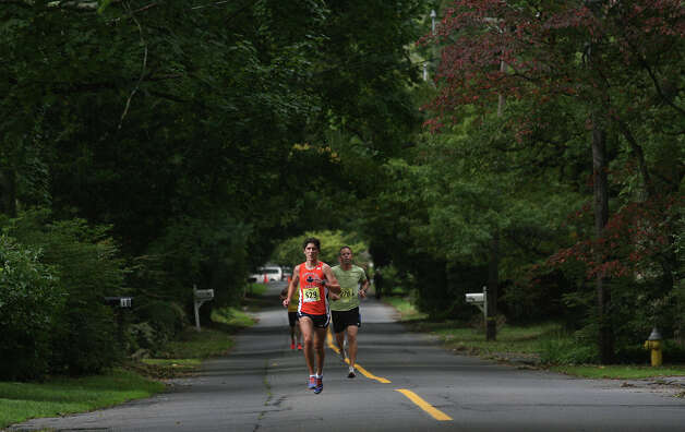 Brendan Rickert, of Danbury, leads the 5k race during the Bigelow  25th Anniversary Community Challenge in Southport, Conn. on September 30, 2012. Photo: Unknown, B.K. Angeletti / Connecticut Post freelance B.K. Angeletti