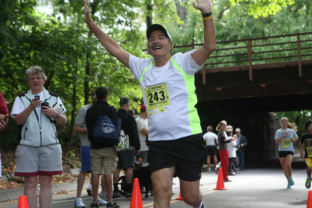 Lou Landman, of Fairfield, finishes the 5k race during the Bigelow  25th Anniversary Community Challenge in Southport, Conn. on September 30, 2012. Photo: Unknown, B.K. Angeletti / Connecticut Post freelance B.K. Angeletti