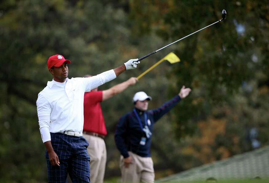 MEDINAH, IL - SEPTEMBER 28:  Tiger Woods of the USA reacts to a poor tee shot on the 15th hole durin