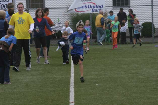 Max Laferriere, 8, runs in the mile race during the Bigelow  25th Anniversary Community Challenge in Southport, Conn. on September 30, 2012. Photo: Unknown, B.K. Angeletti / Connecticut Post freelance B.K. Angeletti