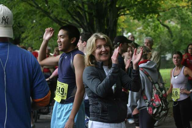 Cindi Bigelow cheers for runners during the Bigelow Tea's 25th Anniversary Community Challenge in Southport, Conn. on September 30, 2012. Photo: Unknown, B.K. Angeletti / Connecticut Post freelance B.K. Angeletti