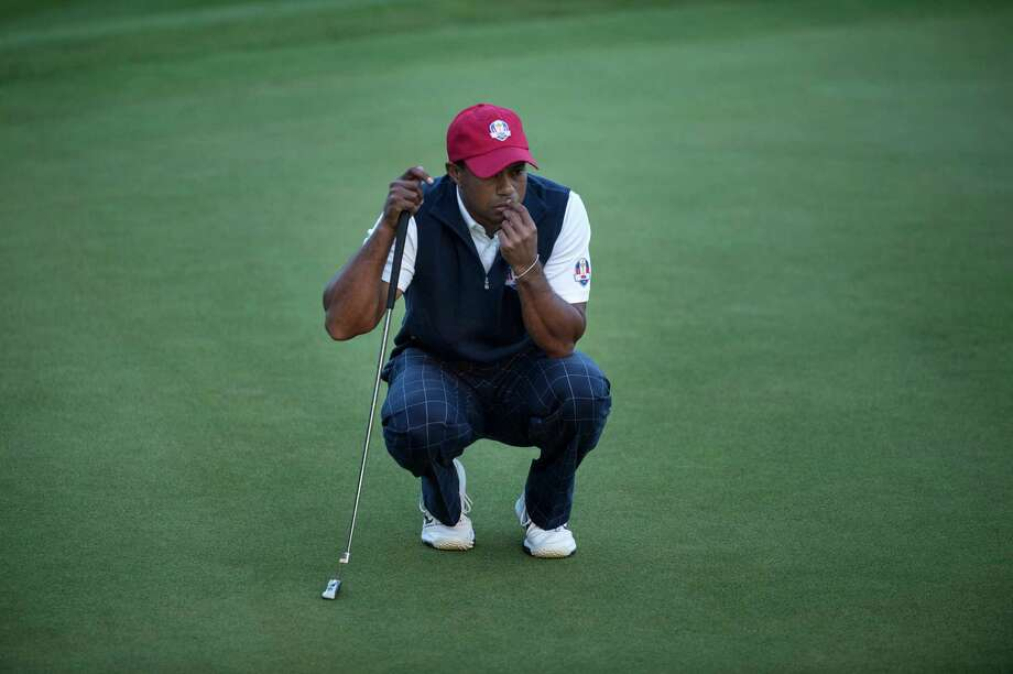 TOPSHOTS Team USA's Tiger Woods line up a put on the 18th hole's green during the afternoon Four Ball Match on the first day of the 39th Ryder Cup at the Medinah Country Club September 28, 2012 in Medinah, Illinois.  AFP PHOTO/Brendan SMIALOWSKIBRENDAN SMIALOWSKI/AFP/GettyImages Photo: BRENDAN SMIALOWSKI, AFP/Getty Images / 2012 Brendan Smialowski