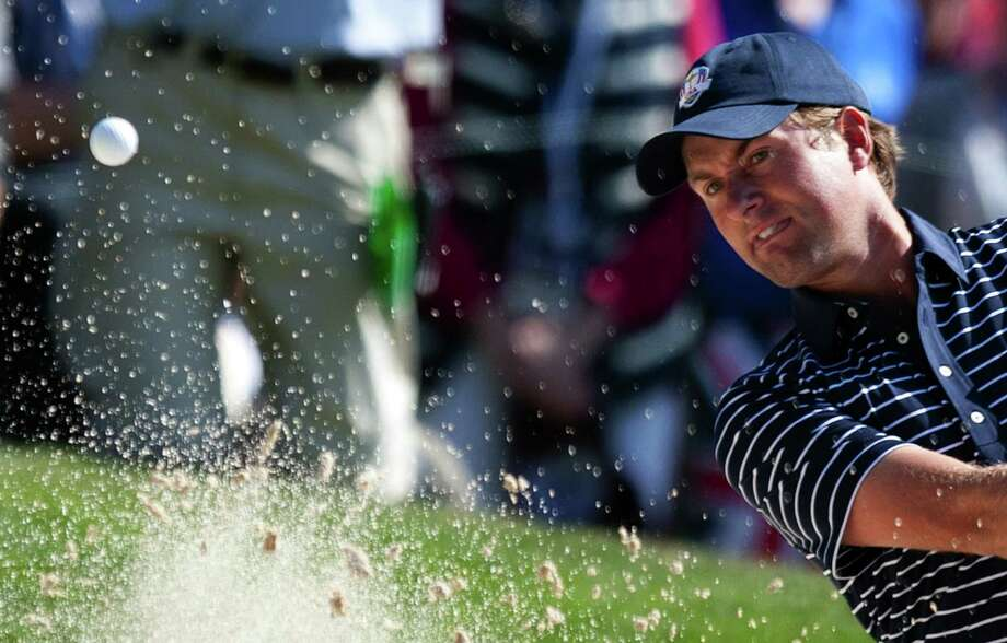 TOPSHOTS Webb Simpson of the US swings from the bunker to the 16th green during The Morning Foursomes on the second day of play for The 39th Ryder Cup at Medinah Country Golf Club on September 29, 2012 in Medinah, Illinois.                            AFP PHOTO/Jim WATSONJIM WATSON/AFP/GettyImages Photo: JIM WATSON, AFP/Getty Images / AFP ImageForum