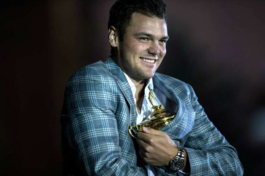 TOPSHOTS  Team Europe's Martin Kaymer of Germany poses with the Ryder Cup after the final day of the 39th Ryder Cup at the Medinah Country Club September 30, 2012 in Medinah, Illinois. Europe produced the greatest comeback in Ryder Cup history to reel in the United States and retain the trophy.  AFP PHOTO/Brendan SMIALOWSKIBRENDAN SMIALOWSKI/AFP/GettyImages Photo: BRENDAN SMIALOWSKI, AFP/Getty Images / 2012 Brendan Smialowski