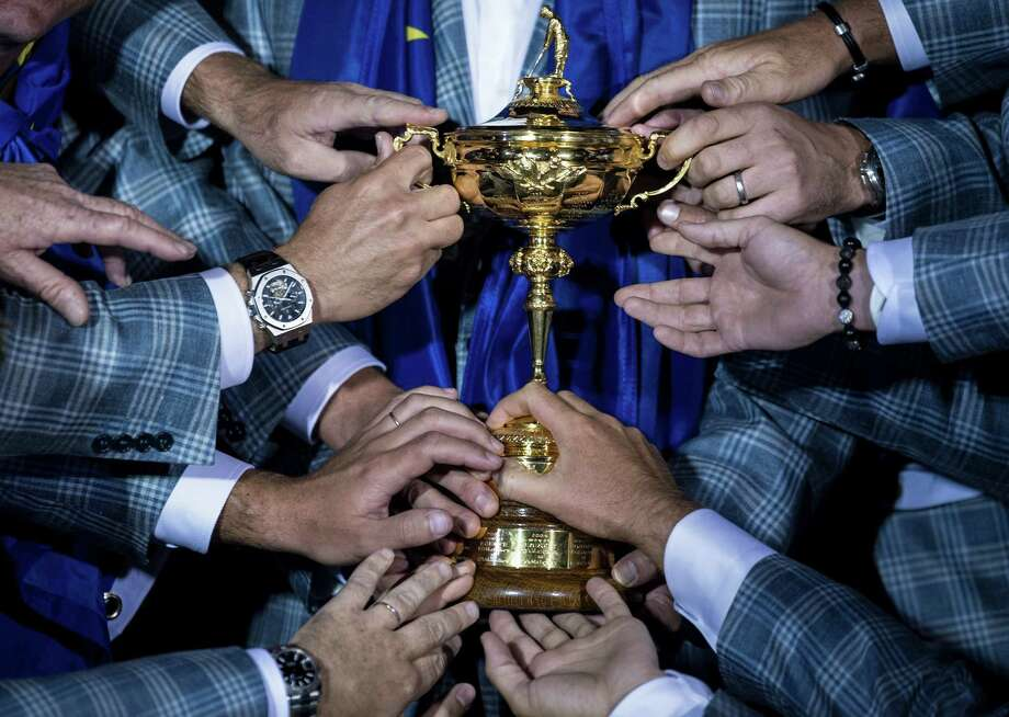 TOPSHOTS  Members of Team Europe hold the Ryder Cup after the final day of the 39th Ryder Cup at the Medinah Country Club September 30, 2012 in Medinah, Illinois. Europe produced the greatest comeback in Ryder Cup history to reel in the United States and retain the trophy.  AFP PHOTO/Brendan SMIALOWSKIBRENDAN SMIALOWSKI/AFP/GettyImages Photo: BRENDAN SMIALOWSKI, AFP/Getty Images / 2012 Brendan Smialowski