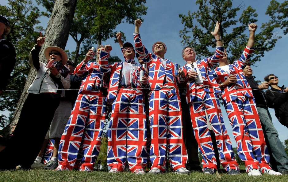 Fans cheer for Europe's Ian Poulter on the fourth hole during a practice round at the Ryder Cup PGA