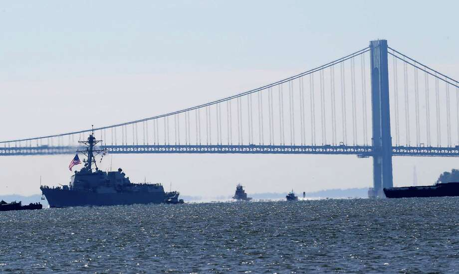 The USS Michael Murphy, a new Navy destroyer named after a Navy SEAL killed in Afghanistan, chugs past the Verrazano Bridge along the Hudson River Monday, Oct. 1, 2012, in Jersey City, N.J.  Photo: Julio Cortez, Associated Press / AP