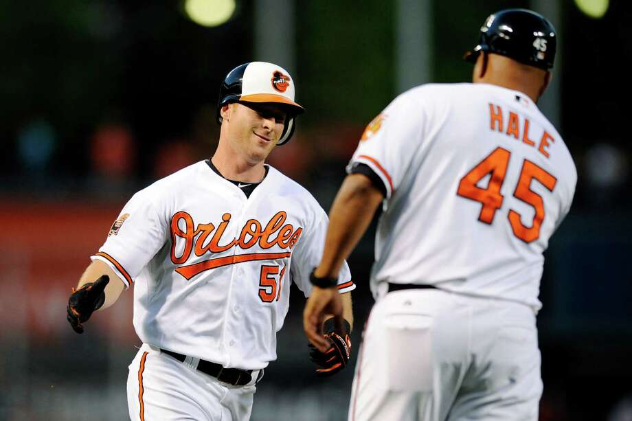 Baltimore Orioles' Lew Ford, left, is greeted by third base coach DeMarlo Hale (45) after hitting a home run against the Chicago White Sox during the second inning of a baseball game, Monday, Aug. 27, 2012, in Baltimore. (AP Photo/Nick Wass) Photo: Nick Wass, FRE