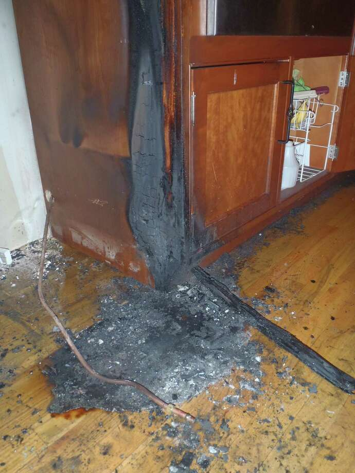 Fire in a Darbrook Road home's kitchen Monday morning burned sections of the kitchen and the floor. Photo: Westport Fire Department / Westport News contributed