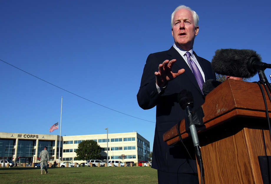 Senator John Cornyn answers questions from the media outside III Corps headquarters Friday Nov. 6, 2009 on Fort Hood Army Base in Fort Hood, Tx. Photo: EDWARD A. ORNELAS, San Antonio Express-News / San Antonio Express-News