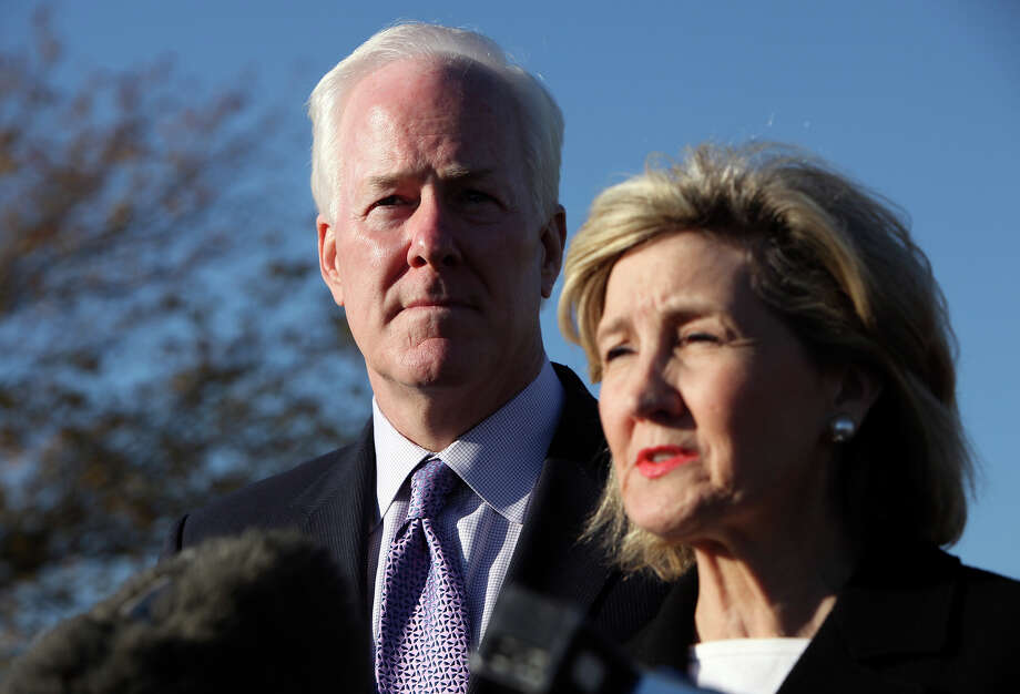 John Cornyn listens to Kay Bailey Hutchison speak during a press conference outside III Corps headquarters Friday Nov. 6, 2009 on Fort Hood Army Base in Fort Hood, Tx. Photo: EDWARD A. ORNELAS, San Antonio Express-News / San Antonio Express-News
