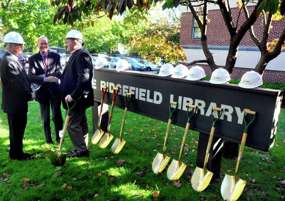Ridgefield First Selectman Rudy Marconi, left, Capitol Campaign Chairman Philip Lodewich, and President of the Library Board Peter Coffin, right, talk before a ceremony marking the start of construction on the new Ridgefield Library, Monday, Oct. 1, 2012. Photo: Michael Duffy