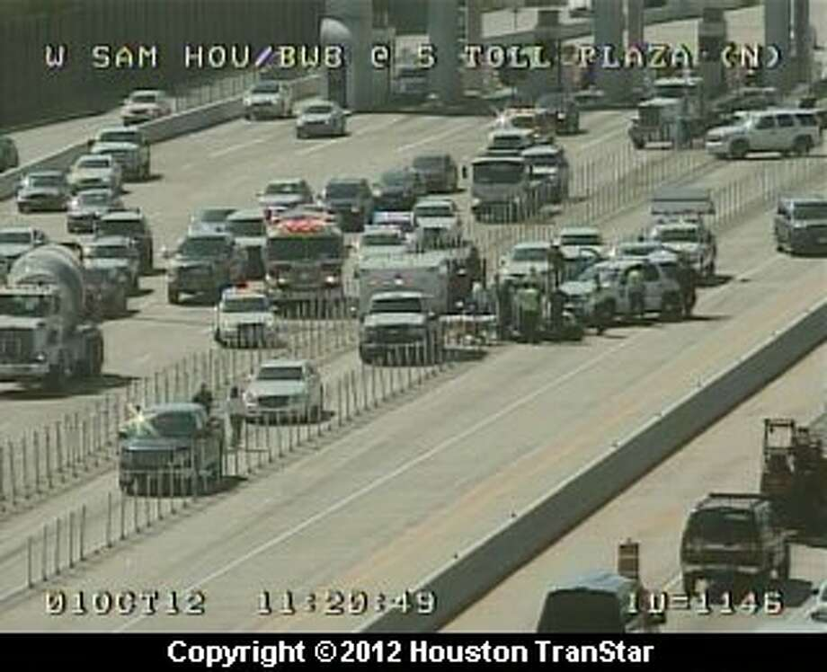 A Harris County Precinct 5 Constable's Office motorcycle officer was involved in a traffic crash on the West Sam Houston Parkway near the south toll plaza late Monday morning. (Houston TranStar) Photo: Houston Transtar