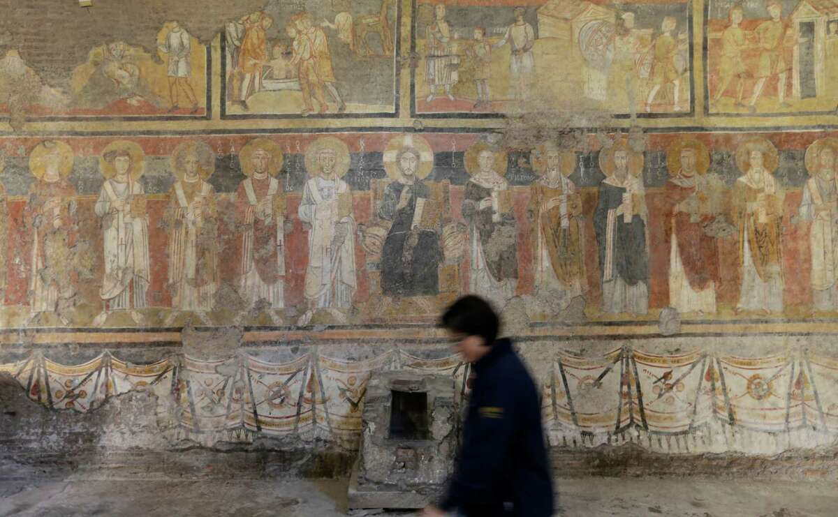 A partial view of the frescoes painted on the wall of the Ancient Church of St. Mary in the Roman forum, Monday, Oct. 1, 2012. Italy's Ministry of Culture allowed media in Monday for a preview of a massive restoration of what experts call the Sistine Chapel of the VIII century, a series of medieval byzantine frescoes painted on the walls of this church over the course of three centuries. The Ancient Church of St. Mary was founded in the sixth century, in between imperial Roman palaces. It was the oldest and most important Christian monument in the Roman forum. (AP Photo/Alessandra Tarantino)