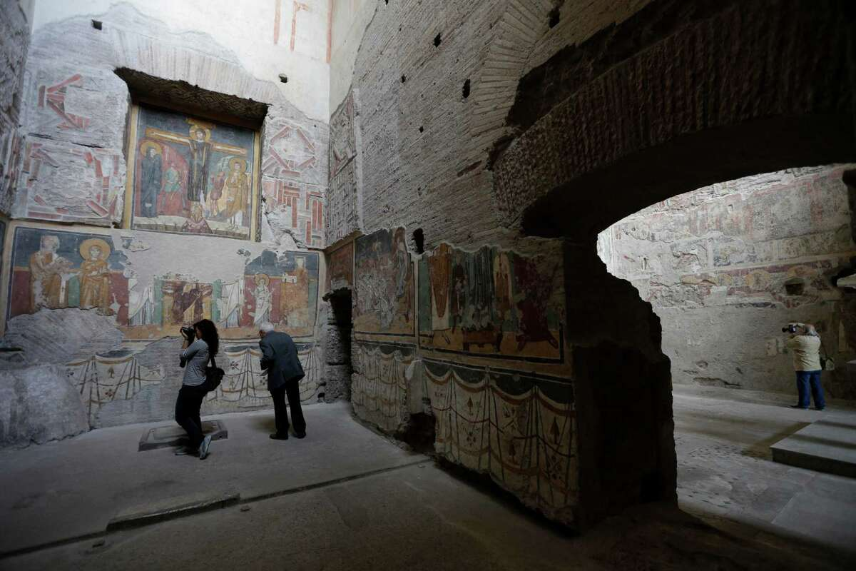 A view of the frescoes painted on the wall of the Ancient Church of St. Mary in the Roman forum, Monday, Oct. 1, 2012. Italy's Ministry of Culture allowed media in Monday for a preview of a massive restoration of what experts call the Sistine Chapel of the VIII century, a series of medieval byzantine frescoes painted on the walls of this church over the course of three centuries. The Ancient Church of St. Mary was founded in the sixth century, in between imperial roman palaces. It was the oldest and most important Christian monument in the Roman forum. (AP Photo/Alessandra Tarantino)