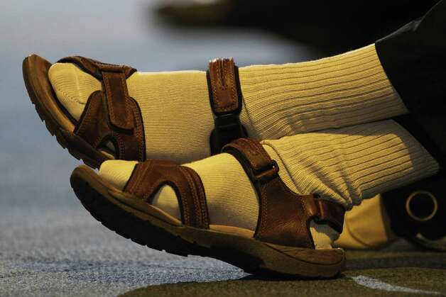 Chanclas con socks are still a thing. Photo: Dan Kitwood, . / 2011 Getty Images