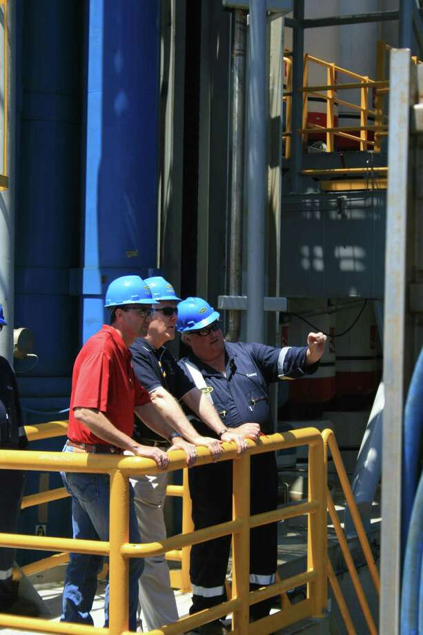 Rep. Pete Olson and Sen. John Cornyn listen to Noble Corp.'s Tommy Travis discuss blowout preventers aboard Noble's Danny Adkins rig in the Gulf of Mexico on July 6, 2010. Photo: Loren Steffy, Houston Chronicle / Houston Chronicle