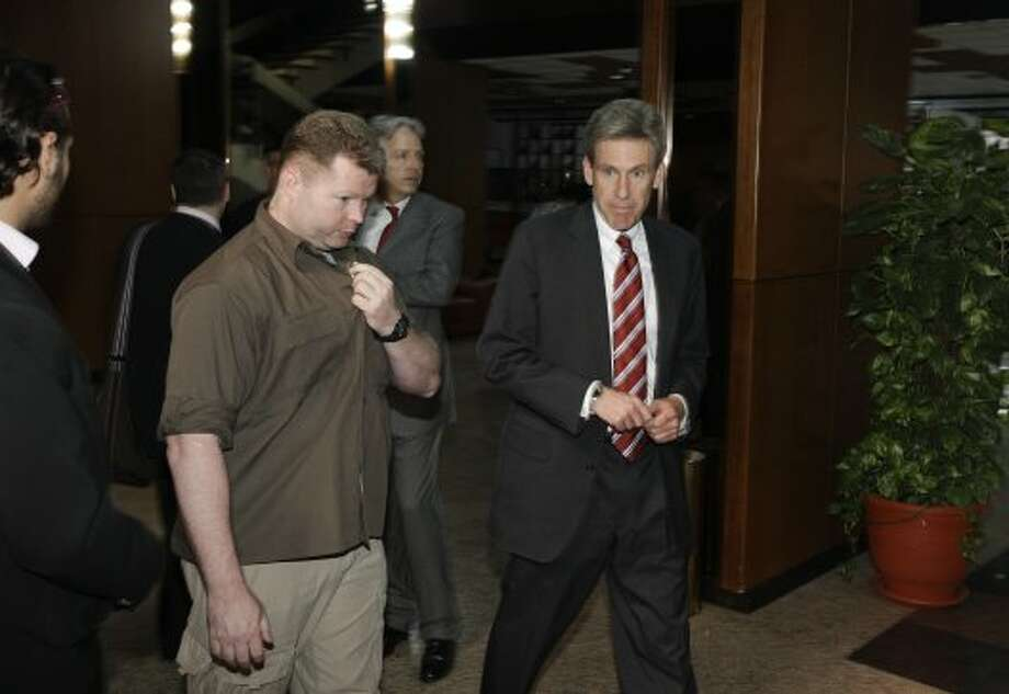 In this photo taken Monday, April 11, 2011, then U.S. envoy Chris Stevens, right, is accompanied by an unidentified member of security personnel, left, as he attends meetings at the Tibesty Hotel where an African Union delegation was meeting with opposition leaders in Benghazi, Libya. Libyan officials say the U.S. ambassador and three other Americans have been killed in an attack on the U.S. consulate in the eastern city of Benghazi by protesters angry over a film that ridiculed Islam's Prophet Muhammad. (AP Photo/Ben Curtis) (Ben Curtis / Associated Press)