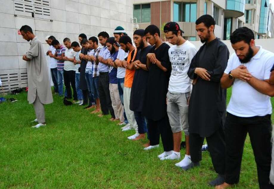 Muslims pray outside the United States embassy in Tunis, Wednesday, Sept.12, 2012 and demand the closure of the embassy. The American embassies in Algeria and Tunisia warned of more protests Wednesday, following attacks by protesters in neighboring Libya in which the U.S. ambassador and three embassy staff were killed. (Hassene Dridi / Associated Press)
