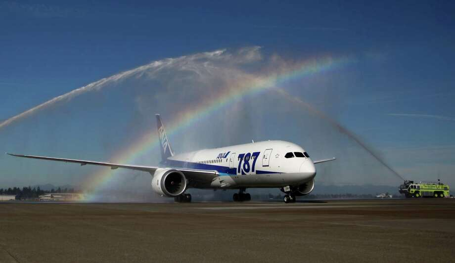 An ANA 787 arrives to a turret salute by Sea-Tac pumper trucks at Sea-Tac Airport. Photo: JOSHUA TRUJILLO / SEATTLEPI.COM