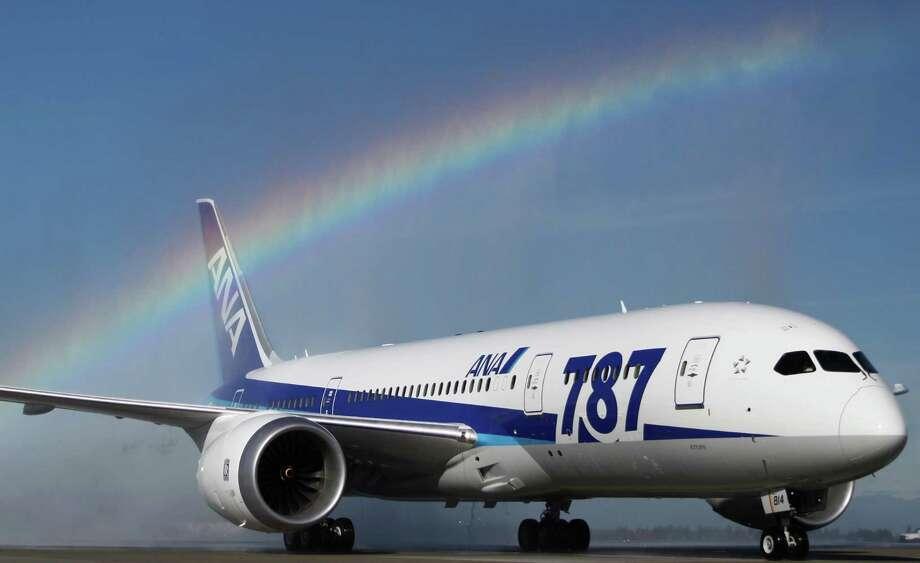 An ANA 787 arrives to a turret salute at Sea-Tac Airport on Monday. Photo: JOSHUA TRUJILLO / SEATTLEPI.COM