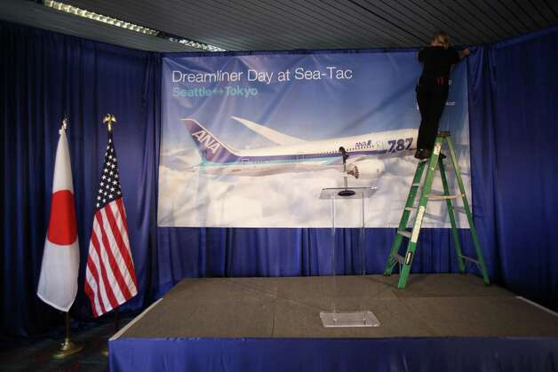 A podium is prepared as an ANA 787 arrives at Sea-Tac Airport on Monday. The plane is the first Boeing 787 commercial service to the Seattle area.  Photo: JOSHUA TRUJILLO / SEATTLEPI.COM