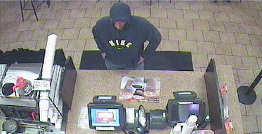Milford, Conn. police are trying to identify this man, who they say robbed Dunkin Donuts, 1353 New Haven Ave., at knifepoint on Friday, Sept. 28, 2012. Photo: Contributed