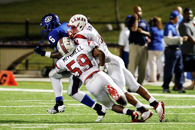 West Brook wide receiver Ladarious Spearman gets a 7 yard gain before being tackled by Lamar linebacker Kyran Mitchell at the Beaumont ISD Thomas Center on Saturday, September 15, 2012. Photo taken: Randy Edwards/The Enterprise Photo: Randy Edwards