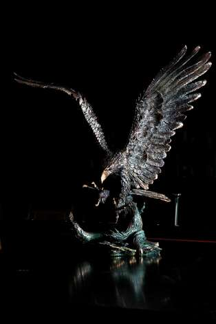 A bronze eagle statue, value unknown, will be auctioned off by Seth Worstell Auction Co., to raise funds that will be used in part to repay victims of imprisoned R. Allen's Stanford on Thursday, Sept. 27, 2012, in Houston. The Saint Croix, U.S. Virgin Islands, assets will be auctioned off which includes several golf carts, a baby grand piano and some expensive jewelry. Photo: Mayra Beltran, Houston Chronicle / © 2012 Houston Chronicle