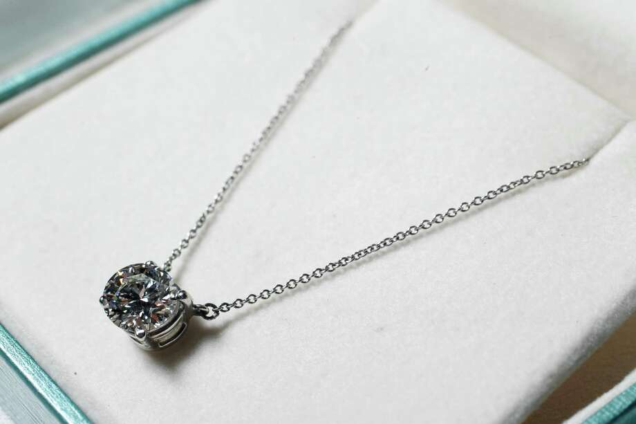 A 1.75 ct. Tiffany & Co. platinum setting necklace, valued at  $75,000.00, is one of many items part of the auction of Stanford Financial Group's assets to raise funds that will be used in part to repay victims of imprisoned R. Allen's Stanford on Thursday, Sept. 27, 2012, in Houston. Photo: Mayra Beltran, Houston Chronicle / © 2012 Houston Chronicle