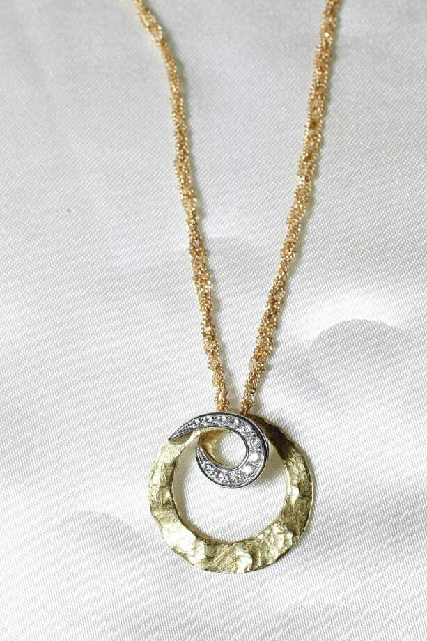 A gold and diamond neckless, unknown value, will part of Stanford Financial Group's assets auctioned to raise funds that will be used in part to repay victims of imprisoned R. Allen's Stanford on Thursday, Sept. 27, 2012, in Houston. Photo: Mayra Beltran, Houston Chronicle / © 2012 Houston Chronicle