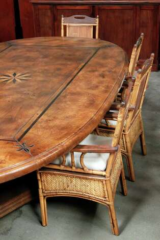 Antique table valued at $30,000 will part of Stanford Financial Group's assets auctioned as part of a fundraiser to repay victims of imprisoned R. Allen's Stanford on Thursday, Sept. 27, 2012, in Houston. Photo: Mayra Beltran, Houston Chronicle / © 2012 Houston Chronicle