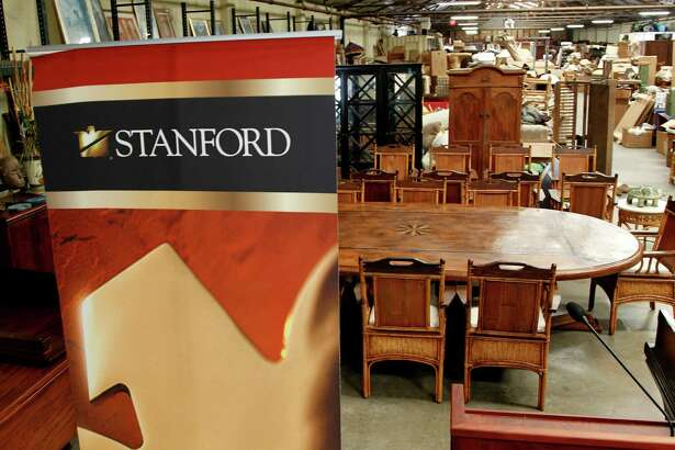 Stanford Financial Group's assets will be auctioned in attempts to fundraise money to repay victims of imprisoned R. Allen's Stanford on Thursday, Sept. 27, 2012, in Houston.