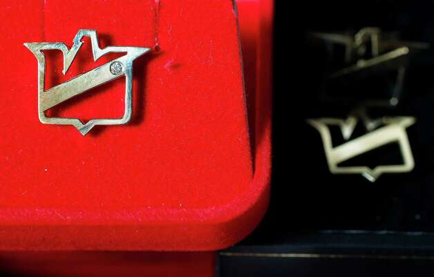 Cuff Links belonging to Allen Stanford, unknown value, will part of Stanford Financial Group's assets auctioned as part of a fundraiser to repay victims of imprisoned R. Allen's Stanford on Thursday, Sept. 27, 2012, in Houston. Photo: Mayra Beltran, Houston Chronicle / 2012 Houston Chronicle