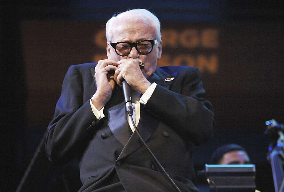 Harmonica virtuoso Toots Thielemans arrived onstage in a wheelchair but performed with guests at Lincoln Center in N.Y. to celebrate his 90th birthday. Photo: Tom Pich, Associated Press