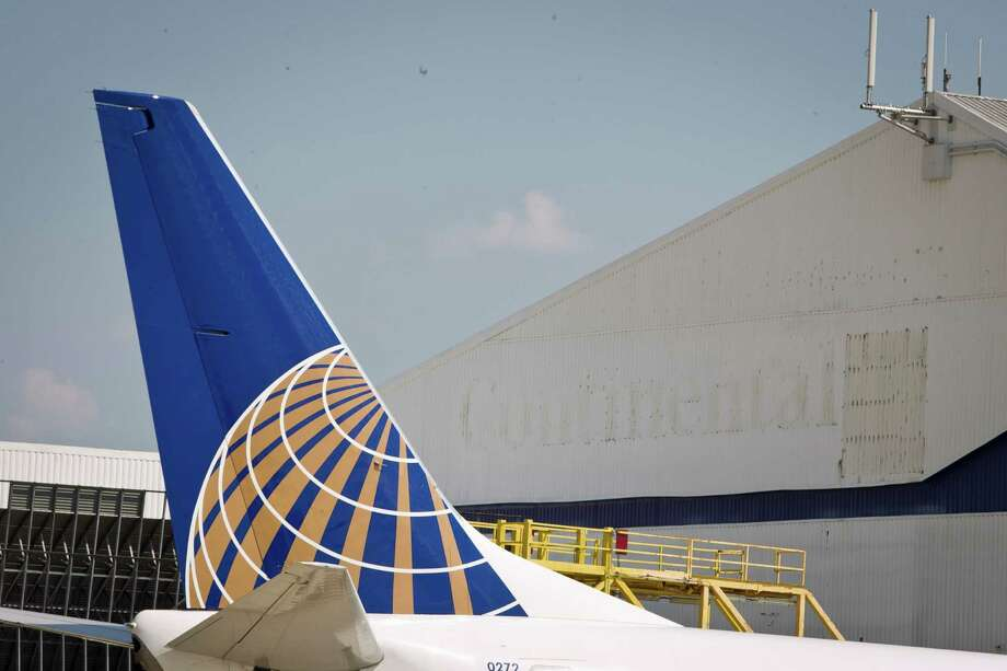Faint Continental Airlines signage remains on an airplane hangar, Wednesday, Sept. 26, 2012, at George Bush Intercontinental Airport  in Houston. October first marks two years since the United-Continental merger closed. ( Nick de la Torre / Houston Chronicle ) Photo: Nick De La Torre / © 2012 Houston Chronicle