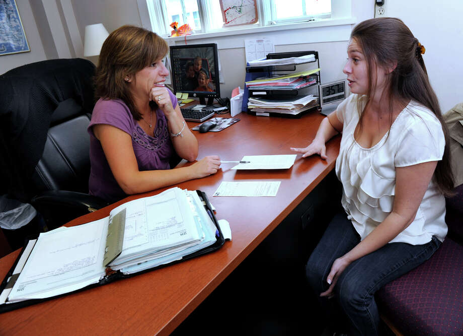 Kathleen Nugent, left, owner of Marie Nugent Personnel Services on North Street in Danbury, talks with client Samantha O'Connor of New Milford, Friday, Sept. 28, 2012. Photo: Carol Kaliff