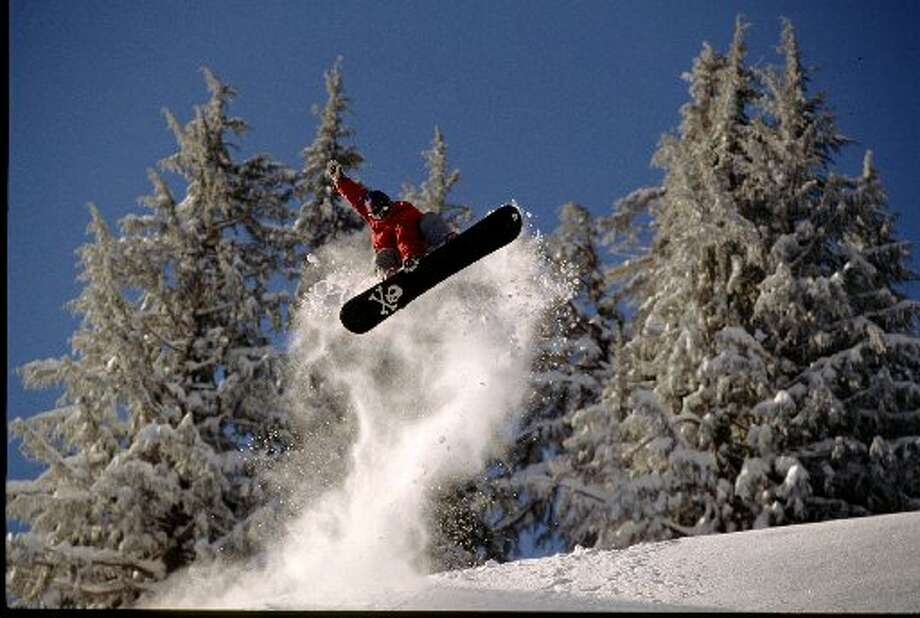 A snowboarder catches air at Bear Valley Mountain Ski Resort. (Tim Bottomley / San Francisco Chronicle)