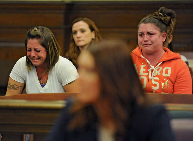Shannon Pozniakas is emotional as she listens to her former friend Robert Hayden of Troy give details of what happened as he pleads guilty to murder and manslaughter in a courtroom in the Rensselaer County Court House on Monday, Oct 1, 2012 in Troy, N.Y. Hayden told police he performed CPR on her toddler for two hours after he allegedly put his hand over the crying boy's mouth and he stopped breathing. (Lori Van Buren / Times Union) Photo: Lori Van Buren