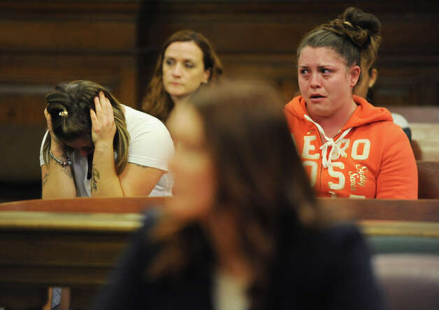 Shannon Pozniakas, left, is emotional as she listens to her former friend Robert Hayden of Troy give details of what happened as he pleads guilty to murder and manslaughter in a courtroom in the Rensselaer County Court House on Monday, Oct 1, 2012 in Troy, N.Y. Hayden told police he performed CPR on her toddler for two hours after he allegedly put his hand over the crying boy's mouth and he stopped breathing. (Lori Van Buren / Times Union) Photo: Lori Van Buren