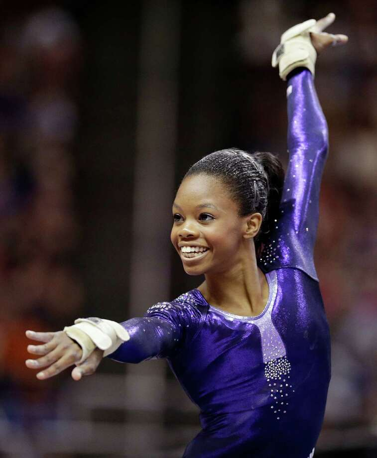 Gabby Douglas performs in the floor exercise during the final round of the women's Olympic gymnastics trials, Sunday, July 1, 2012, in San Jose, Calif. Douglas was named to the U.S. Olympic gymnastics team.  (AP Photo/Jae C. Hong) Photo: Jae C. Hong, STF / AP