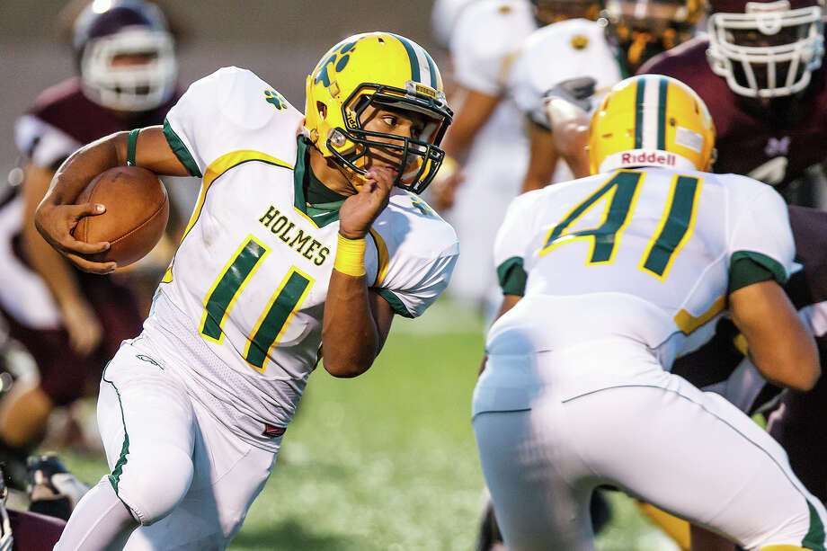 Holmes quarterback Gilbert Garcia runs to his right for a three-yard touchdown during the first quarter of their game with Marshall at Farris Stadium on Sept. 20, 2012. Photo: MARVIN PFEIFFER, Marvin Pfeiffer / Northwest Weekly / Prime Time Newspapers 2012