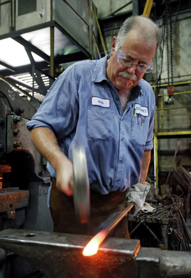 In this Thursday, Sept. 6, 2012, photo, Bob Kurz shapes a pry bar at Solmet Technologies in Canton, Ohio.  U.S. stocks rose after a report that manufacturing grew for the first time in four months, buoyed by a jump in new orders in September. Photo: Associated Press / AP