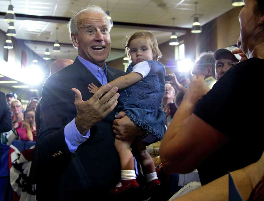 Vice President Joe Biden holds a baby during a campaign event at Milford High School, Sunday, Sept. 9, in Milford, Ohio. (AP Photo/Carolyn Kaster) Photo: Carolyn Kaster, Carolyn Kaster/AP