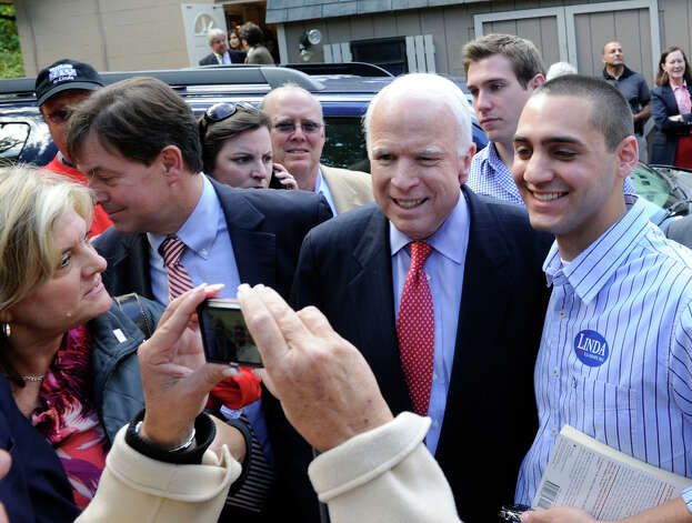 U.S. Senator John McCain, in Danbury to campaign for Linda McMahon, poses for photos with supporters, Monday, Oct. 1, 2012. Photo: Carol Kaliff