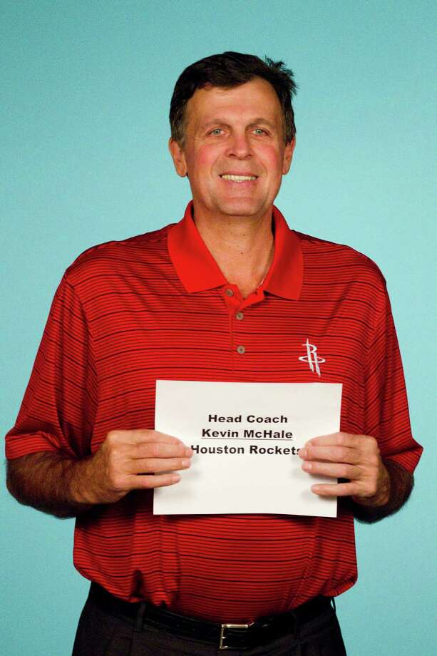 Houston Rockets head coach Kevin McHale holds up a name tag before posing for photos during Rockets Media Day Monday, Oct. 1, 2012, in Houston. Photo: Brett Coomer, Chronicle / © 2012 Houston Chronicle