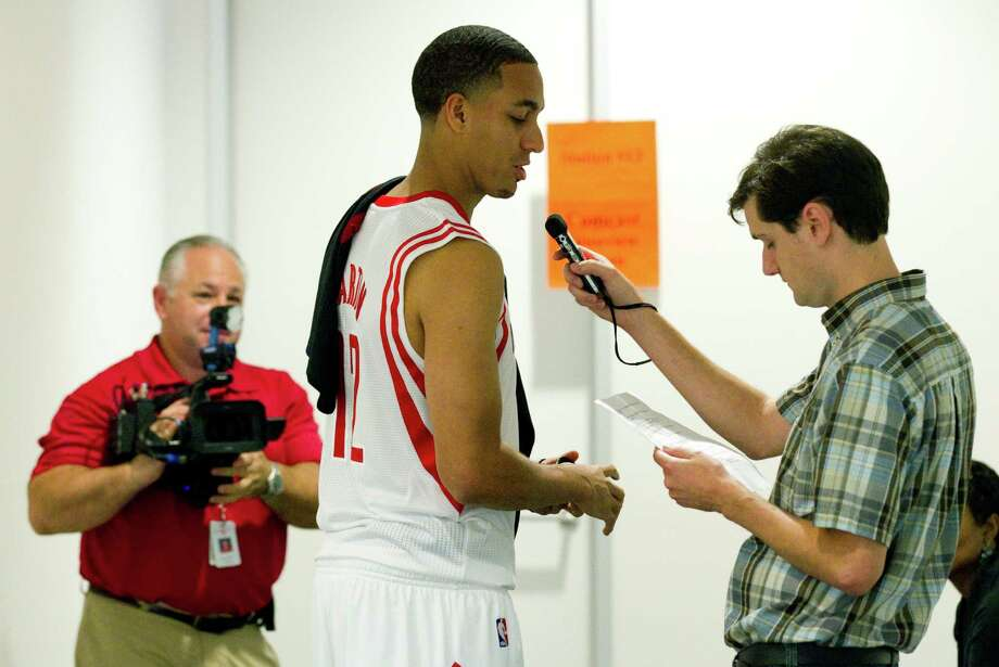 Houston Rockets guard Kevin Martin, center, tapes a radio promotion during Rockets Media Day Monday, Oct. 1, 2012, in Houston. Photo: Brett Coomer, Chronicle / © 2012 Houston Chronicle