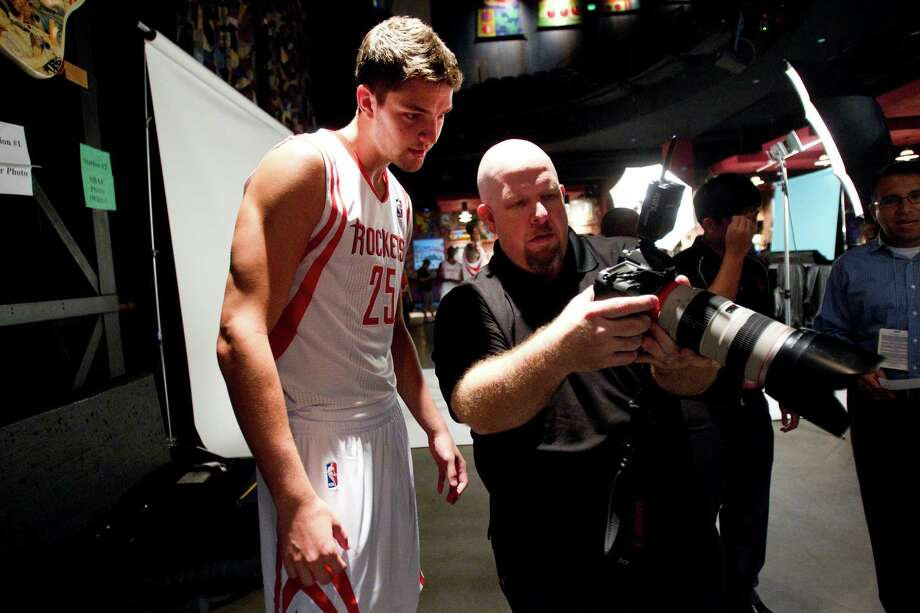 Houston Rockets guard Chandler Parsons, left, looks at photos taken by Troy Fields during Rockets Media Day Monday, Oct. 1, 2012, in Houston. Photo: Brett Coomer, Chronicle / © 2012 Houston Chronicle